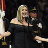 Fergie has apologised for her rendition of the national anthem that left celebrity audience members laughing