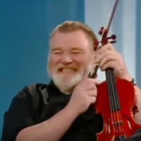 Brendan Gleeson is going to appear on a new Irish folk album because he's actually an amazing fiddle player