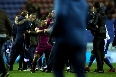 Aguero is confronted after the final whistle.