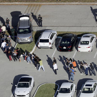 Armed policeman at Parkland school 'never went in' to confront shooter