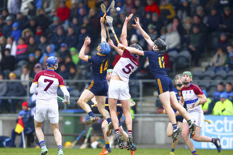 Players from both sides challenge for the ball in Mallow.