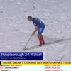 Peterborough defender Steven Taylor resorts to sweeping snow off the pitch mid-game