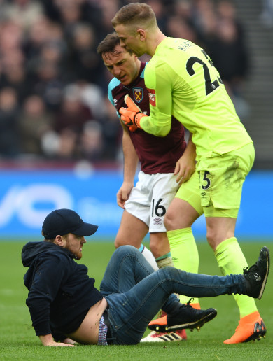 Fans invade London Stadium pitch as Burnley hammer West Ham