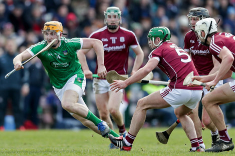 Seamus Flanagan evades the challenge of Greg Lally.