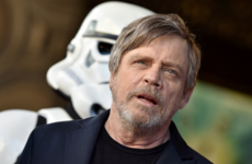 Mark Hamill is scarlet over footage of him wearing a gold jumpsuit and singing in German