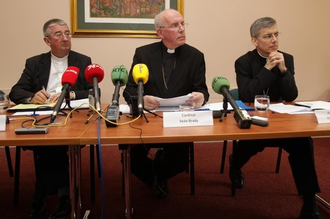 Archbishop of Dublin Diarmuid Martin, Cardinal Sean Brady and papal nuncio to Ireland Archbishop Charles Brown during a press conference in Maynooth this morning.