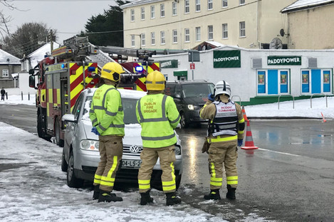 Fire service personnel at the scene of a car accident in Glasnevin, Dublin, last month