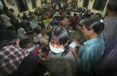 Indonesia slammed by earthquake, volcano, tsunami