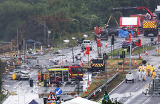 Pilot of jet that crashed onto dual carriageway, killing 11 men, to be charged with manslaughter