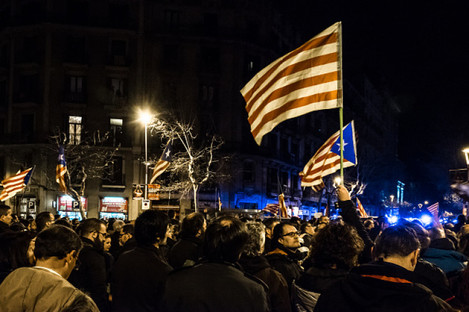 Demonstrators hold Catalan flags in a demonstration in Barcelona this week.