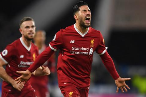 Emre Can celebrates a Liverpool goal.