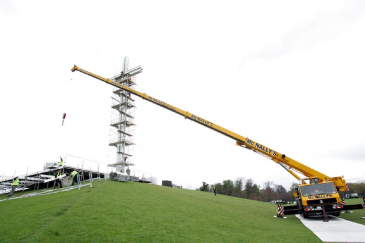 Workers build a stage at the Papal Cross in the Phoenix Park before a special mass for Pope John Paul II on the day of his funeral.