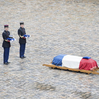 'French spirit of resistance' hailed as hero policeman laid to rest