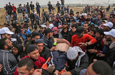 12 dead after clashes erupt as thousands of Gazans march near Israel border