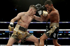 Ryan Burnett suffers suspected broken hand early but stylishly retains world title