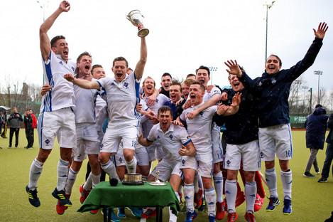 Three Rock Rovers captain Jody Hosking lifts the Irish Senior Cup.