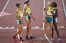 Australian athletes wait nearly four minutes to hug the last-place finisher in the 10,000m
