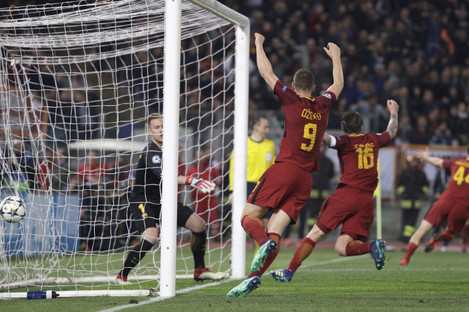 Roma players celebrate with teammate Kostas Manolas, second right, after he scored his side's third goal.
