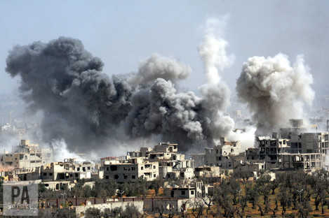 File photo of smoke rising after the Syrian army's shelling targeted the Douma district in Eastern Ghouta.