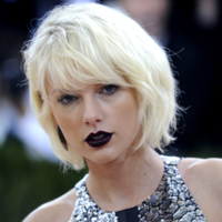 A Taylor Swift fan robbed a bank and threw the cash into her garden before his arrest