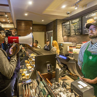 Starbucks CEO apologises after two black men arrested in café while waiting for a friend