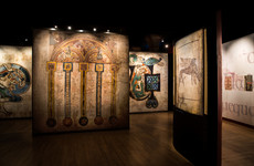 What brings visitors into see the Book of Kells? Rain, apparently
