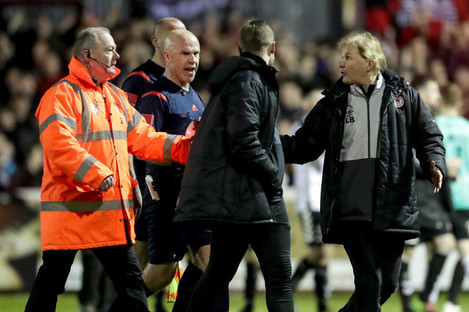 Saints boss Liam Buckley (right) and coach Ger O'Brien complain to referee Tomas Connolly after the final whistle.