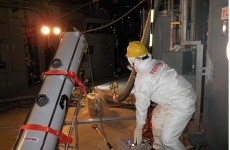 Examination reveals very high radiation, little water in Japan reactor
