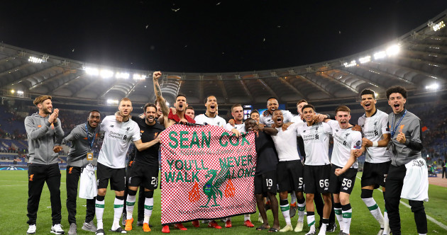 Liverpool celebrate Champions League semi-final win with flag paying tribute to injured Irish fan