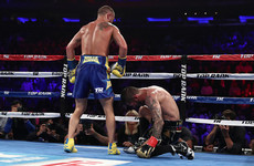 Lomachenko climbs off canvas to become three-weight world champ with stunning stoppage