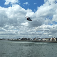 Coast Guard helicopter rescues three men who jumped into water at Clontarf's Wooden Bridge