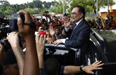 Scenes of joy and celebration as Malaysian politician jailed for sodomy is freed