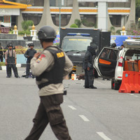 Men attack police headquarters with samurai swords in Indonesia days after suicide bombings