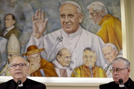 Chilean bishops Luis Fernando Ramos Perez, left, and Juan Ignacio Gonzalez, meet reporters at the Vatican