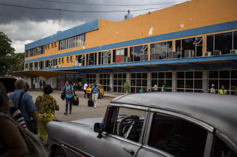 Travellers walk outside Jose Marti International Airport Terminal 1 in Havana.