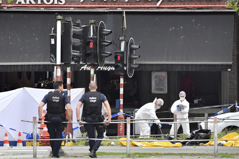 Forensic police investigate at the scene of a shooting in Liege, Belgium