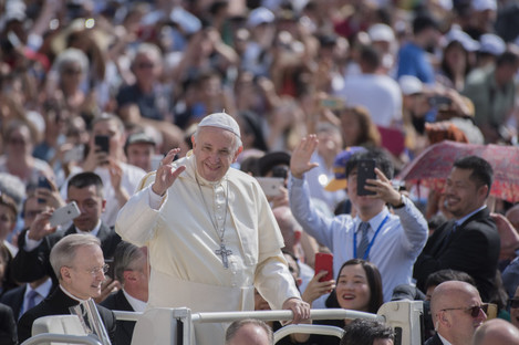 Pope Francis waves as he arrives for his weekly general audience in St. Peter's Square in the Vatican City yesterday.