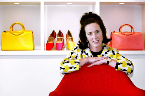Spade is pictured with handbags and shoes from one of her collections in 2004.