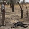 Why is George Clooney watching Sudan via satellite?
