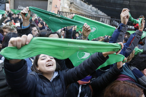 Women celebrate the approval of the bill in Buenos Aires.