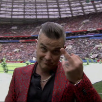 Fox have apologised for broadcasting Robbie Williams sticking up his middle finger at the World Cup
