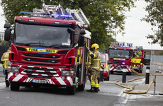 Men rushed to hospital after son tries to save father after he fell into fire