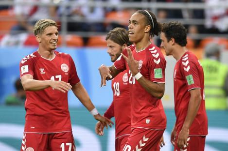 Denmark's Yussuf Yurary Poulsen, second right, celebrates with his teammates.