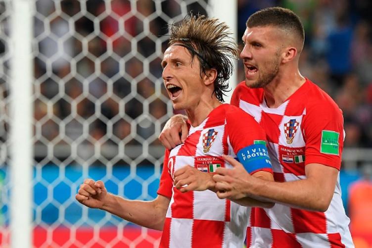 Modric celebrates alongside team-mate Ante Rebic on Saturday.