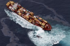 New Zealand charges owner of grounded ship