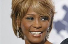Houston autopsy report notes hole in singer's nose