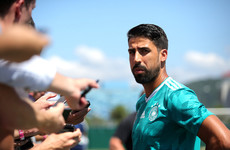 Swedish journalist hands Sami Khedira a boarding pass for early flight home