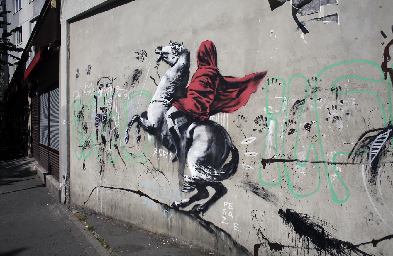 Banksy blitzes paris with graffiti murals commemorating 1968 student revolt