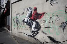 Banksy 'blitzes' Paris with graffiti murals commemorating 1968 student revolt