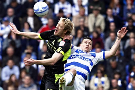 Leeds' Luciano Becchio wins the ball ahead of Reading's Ian Harte during today's clash.